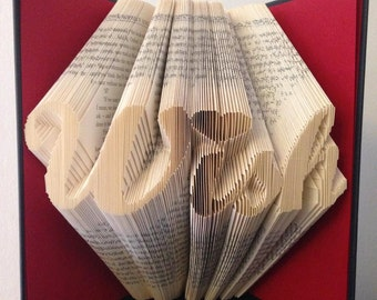 """Book folding pattern for """"Wish"""" in a script style with a heart over the i +Free tutorial"""