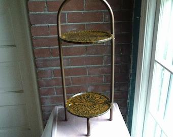 Vintage two tiered metal stand vinegar painted in sienna on black