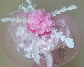 Glamorous pink hat with veil