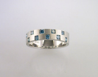 White Gold Ring with Blue Colored Enhanced Diamonds