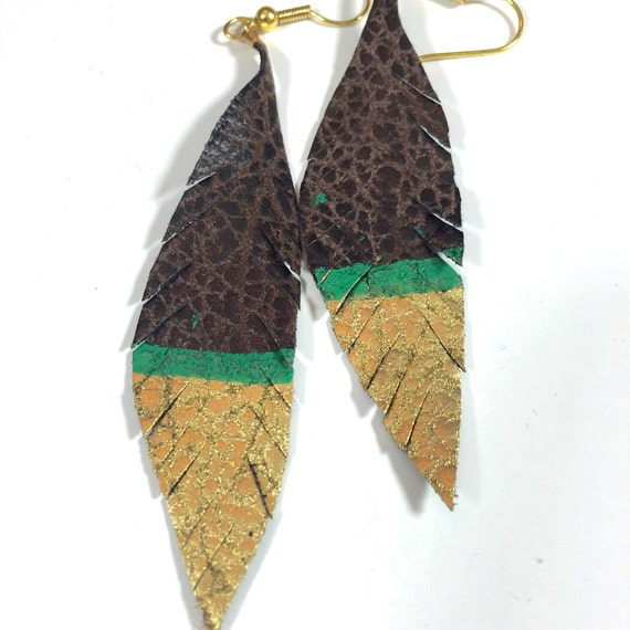 Brown leather feather earrings dipped in gold, turquoise accent