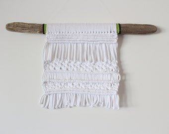 Handmade cotton rope woven macrame wall hanigng on driftwood