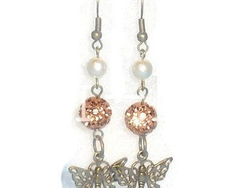 Handmade earrings with butterflies and sequins beads