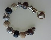 Silver and Gold Beaded Cuff Charm Bracelet With Gemstone Spacers And Porcelain Beads Has A Charm Of Silver Heart Wrapped In Gold Edging