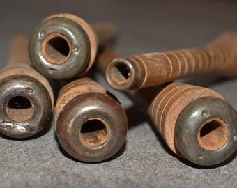 Vintage antique wooden bobbins spools