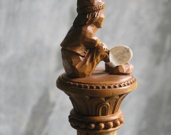 Antique scrocco wood cork figure of elf top a pedestal