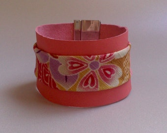 Bracelet typifies cuff in soft leather coral and Japanese fabrics(tissues)