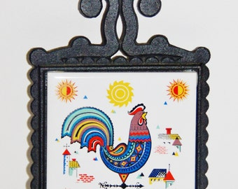 1970s Japanese 'Cherry' footed cast iron trivet with inlaid ceramic tile featuring rooster