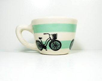 "12oz cup with what we like to call the ""speedy delivery"" bike, on stripes of blue green, made to order / pick your colour"