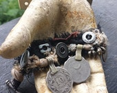 salvaged textile wrist cuff with authenic tribal coin charms and antique buttons, jingle bracelet