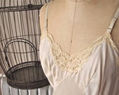 Lorna   Vintage 1960s Wonder Maid Light Beige Full Slip with Lace and Front Slit