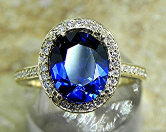 AAA Lab Grown Blue Sapphire 2.84 Carats 10 X 8mm. in a 14k Yellow gold ring with diamonds (.32ct) Ring 1809 MMM