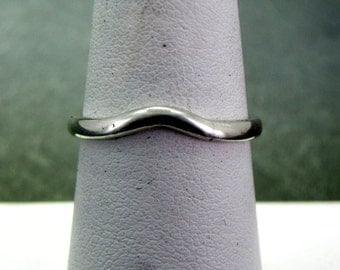 14K white gold curved wedding band.