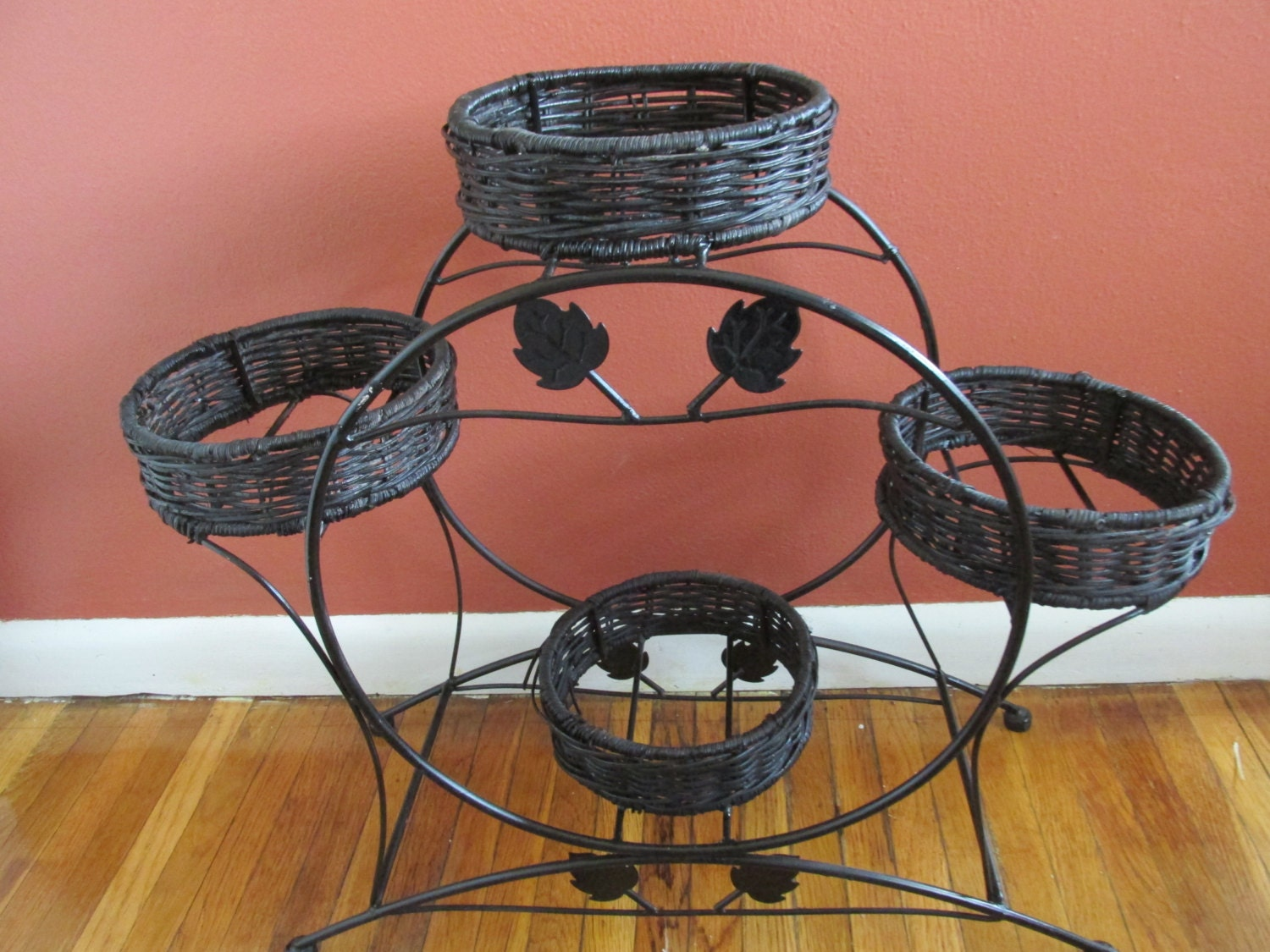 wrought iron plant stand with 4 black wicker planter holders. Black Bedroom Furniture Sets. Home Design Ideas