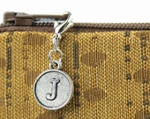 Clip on initial charm for zipper pulls on clutches - stylish accessory creates modern font monogrammed pouch bag