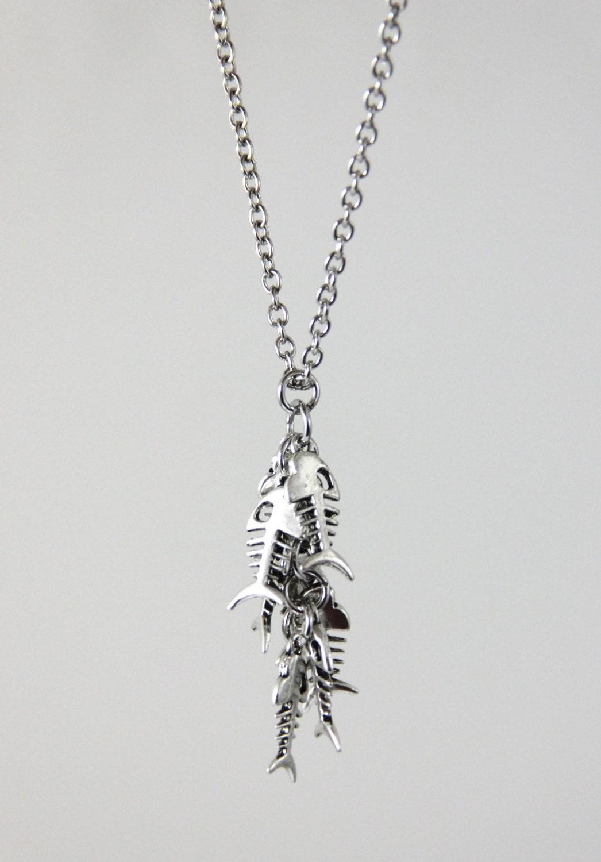 Fish tales silver fish bone skeleton cluster pendant for Fish skeleton necklace
