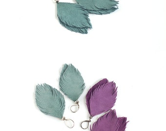 Suede leather feather earrings in violet and in smoky blue. Set of two pairs