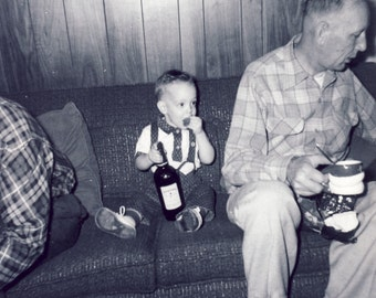 Little Boy About To SNEAK a DRINK of WHISKEY While Grown Ups Look The Other Way Photo Circa 1950s