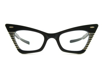 Ray-Ban vintage cat eye glasses. black and white super rare 1960s 1950s black and white striped angled no lenses.