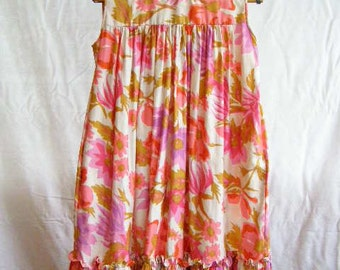 vintage pink floral dress, sleeveless with a pink, purple, and gold pattern