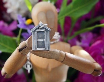 A super cute little solid silver beach hut pendant just for the summer sunshine....