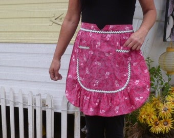 Adorable little vintage half apron Red with Ric Rac, Ruffles, Pocket What more could you want in an apron! NOW ON SALE!!