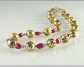 Necklace in Natural Rubies and Gold, 23-Karat Gold Leaf on Lava Stone, Czech Glass, Toggle Clasp, Designer's Signature Tag, 22""