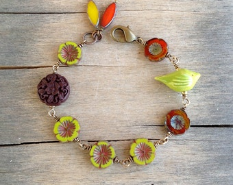 Rustic Wire Wrapped Brass Bracelet with Lime Ceramic Bird and Czech Glass Flower Beads in Rust Orange and Yellow Green with Picasso Finish