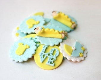 Yellow fondant baby cupcake toppers. Baby fondant toppers. Baby shower cupcake toppers. Baby shower fondant toppers.