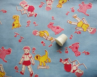 children and puppies playing vintage feedsack fabric