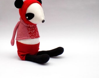Miss Woolly Panda  -  Handmade plush sculpture wearing pink woollen pullover and felt pants.