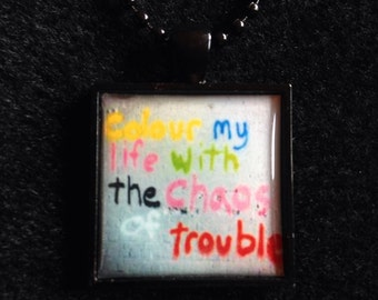 Bookish necklace: Colour my life with the chaos of trouble - Belle and Sebastian - Street art, London