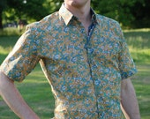 Mens shirt light turquoise floral on ocre separate detailing inside collar, cuffs. Short sleeves. VERY light weight 100% cotton