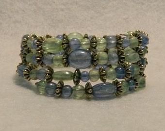 Memory wire bracelet with pale blue and green acrylic beads