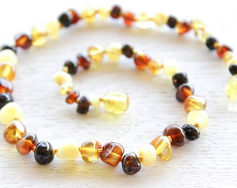 Polished Baltic Amber teething necklace for baby.