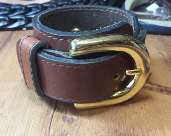 Brown leather cuff with brass buckle