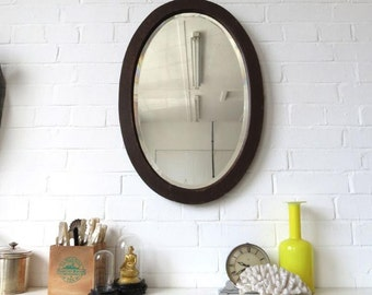 vintage large oval bevelled edge wall mirror with