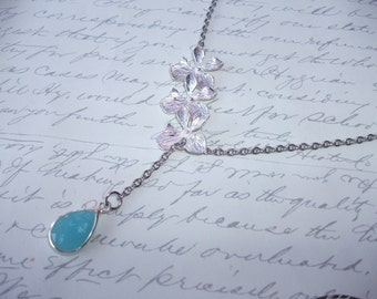 Turquoise drop lariat necklace with silver orchids