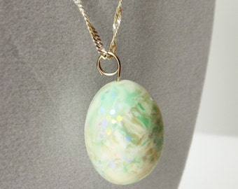 Matte faux opal egg pendant on silver plated chain, 18 inch chain