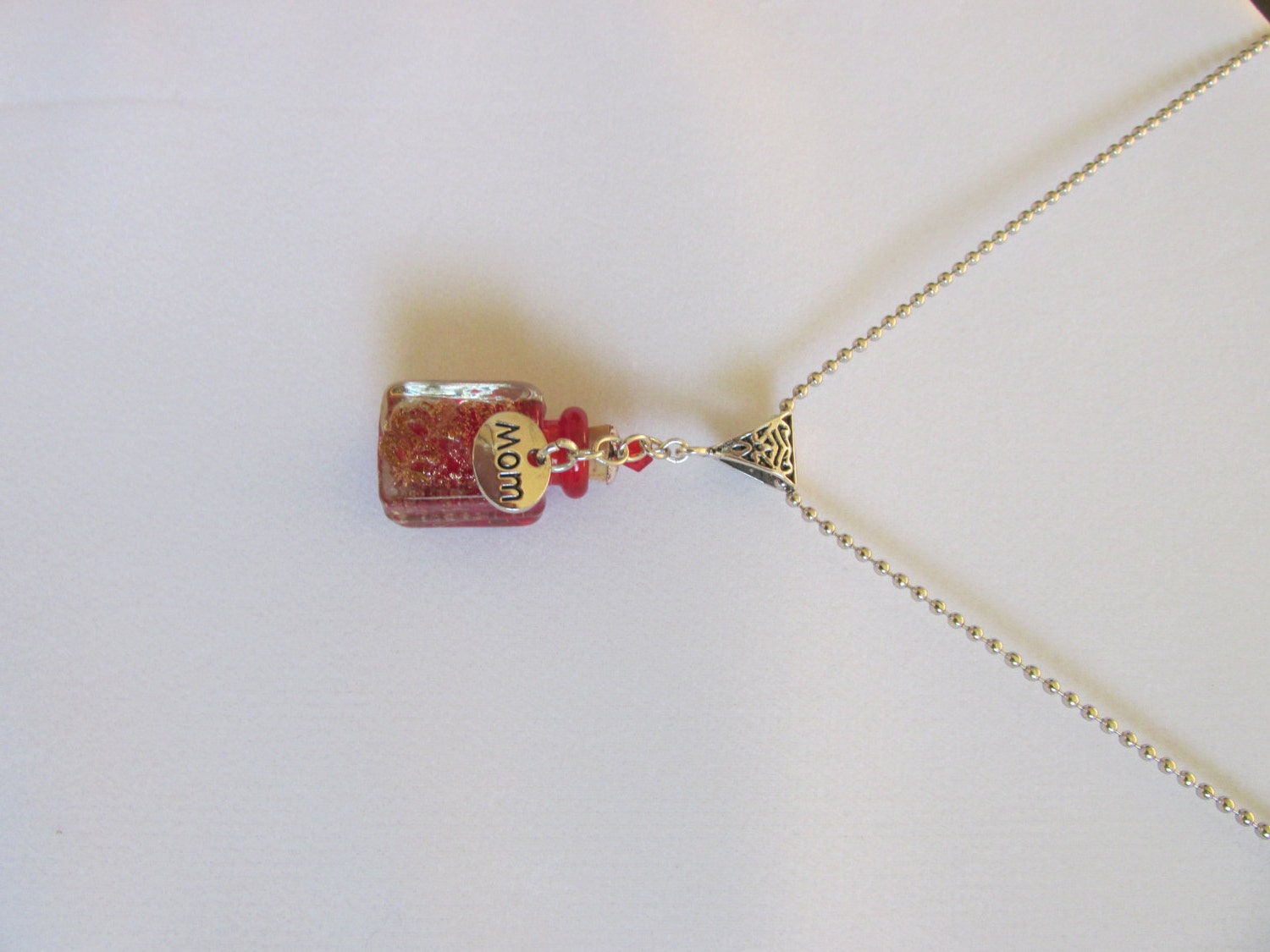 Cremation urn necklace with red murano glass bottle and dad for Father daughter cremation jewelry