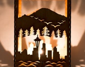 "Seattle City Skyline w/ Mt. Rainier and Evergreen Forest laser cut wood candle luminary. 5""x5""x7"". Tea light included. Free shipping to US."