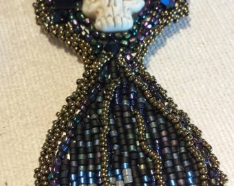 Ravens feathers and skulls by beadworkdreamsraven Laura Mears cabochon Halloween pendent Native American inspired