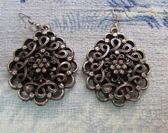 Vintage metal-tone scroll-work medallion earrings, pierced ears
