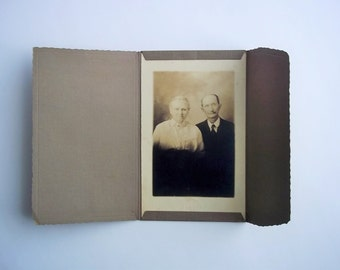 Elderly Couple Studio Photo. Old Vintage Photograph of Older Woman and Man.
