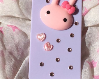 light pink hard plastic case for iPhone 5 decorated. pretty pink bunny, hearts and rhinestones. beautiful iPhone case. bling bling case