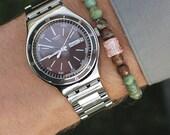 Men's Bracelet. Bead bracelet for men. Jewelry for men. Elastic bracelet. African Opal bead bracelet and rose gold pave detail.
