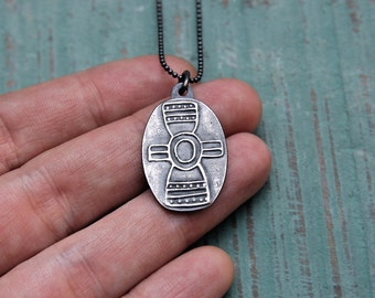Unearthed Symbol pendant