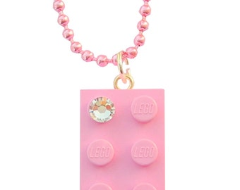 Light Pink LEGO (R) brick 2x4 with a Diamond color SWAROVSKI crystal on a Silver/Gold plated trace chain or on a Pink ballchain