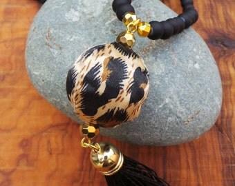 Long beaded black tassel necklace. Animal print necklace.  Boho necklace.  Long black beaded  tassel necklace with animal print bead.