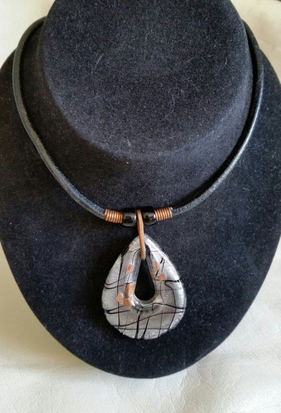 ARTISTIC MURANO PENDANT on Leather Cord. Glass Drop with Copper, Silver & Black Abstract Pattern. Copper Bail, Clasp. 15-1/2 Inches..